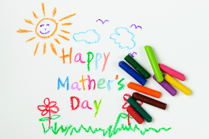 Child drawing of happy mother's day using crayon
